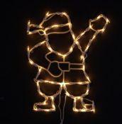 Fensterbild leuchtender Santa